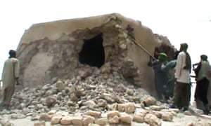 A still from footage of Islamist militants destroying an ancient shrine in Timbuktu