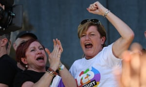 Christine Forster, the sister of former Prime Minister Tony Abbott, celebrates after watching the same sex marriage vote result during a picnic held by the Equality Campaign at Prince Regent Park in Sydney.