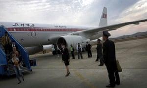 Passengers disembark an Air Koryo flight in Pyongyang in 2014