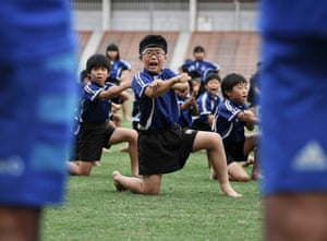 Children perform the haka in front of New Zealand players during a fans' event at Kashiwanoha Park Stadium.