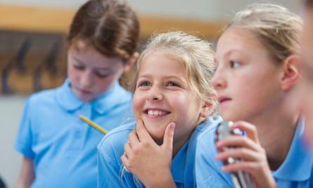 Happy School Girl Listening in Class