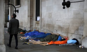 Homeless people sleeping under the portico of St  Paul's Church in Covent Garden, London