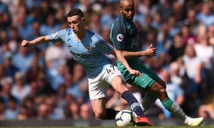 Manchester City's Phil Foden turns away from Lucas Moura at the Etihad Stadium.