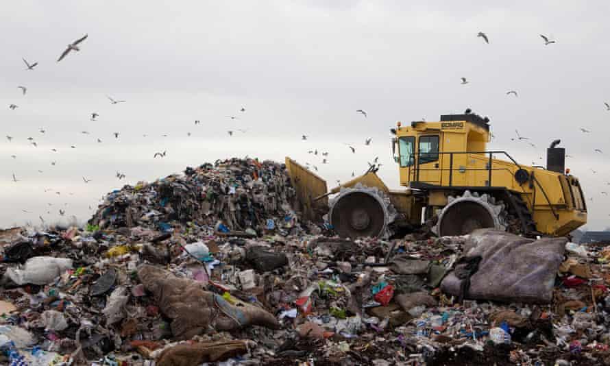 A bulldozer piles waste at a landfill site near Cambridge