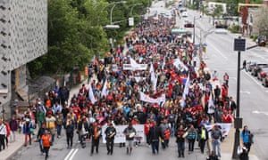 Representatives of First Nations peoples take part in a march in Ottawa on Saturday as the Truth and Reconciliation Commission wrapped up its work.