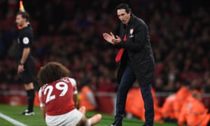 Unai Emery encourages Matteo Guendouzi in typically animated form at the Emirates Stadium on Monday.