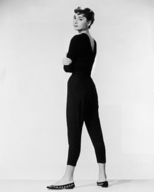 1954: Belgian-born actor Audrey Hepburn, wearing black Capri pants and a black sweater with flats, looks over her shoulder in a full-length promotional portrait for Billy Wilder's film 'Sabrina'. (Photo by Paramount Pictures/Getty Images)