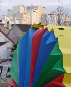 A brightly coloured fan-style pop-up shelter