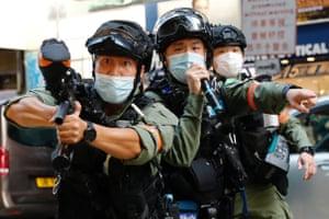 Riot police use pepper spray