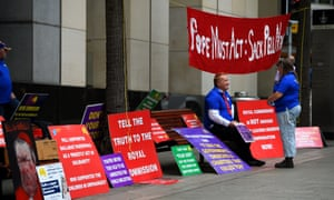 Protesters outside a royal commission hearing