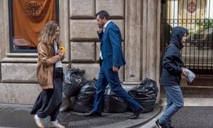 Matteo Salvini, the Italian deputy prime minister and leader of the League, walks near rubbish sacks in Via Condotti, near the Spanish steps