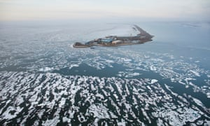 An oil well drilling platform is seen in Prudhoe Bay, Beaufort Sea, near Deadhorse, Arctic Alaska.