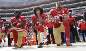Eric Reid (right) has said he will stand for the anthem next season.