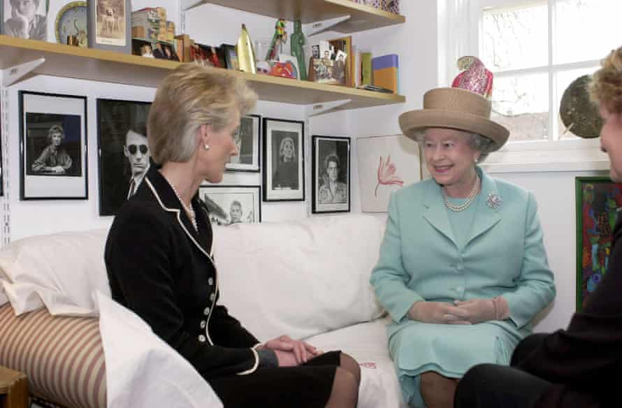 Joanna Trollope with the Queen in 2001. She has been awarded an OBE and a CBE for services to literature