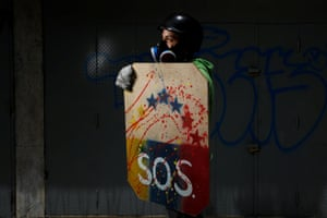Other shields carry quotes and images of Venezuela's constitution, paintings and religious symbols, depictions of the faces of slain protesters, or slogans
