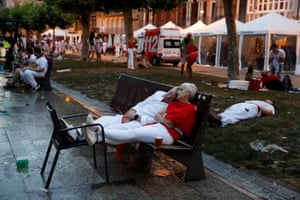 Festivalgoers sleep before the first running of the bulls