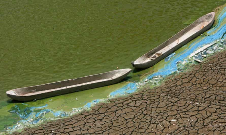 Wooden boats at the base of a dried-up reservoir, Indonesia, during record temperatures in 2015.