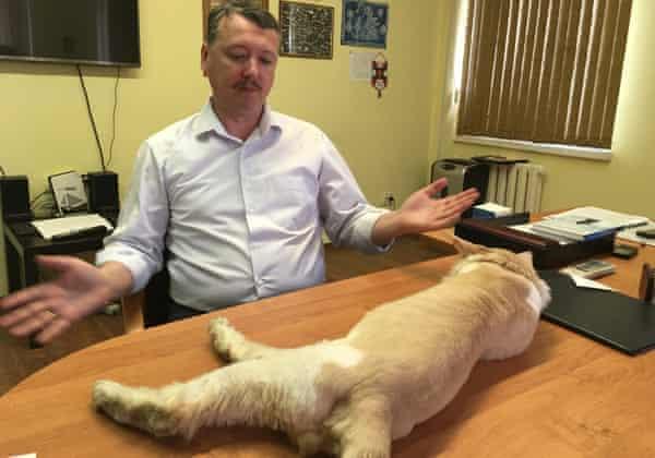 Igor Strelkov with his cat, Grumpy