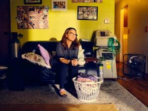 Hotel housekeeper Liza Cruz, 42, poses for a portrait at her home in Auburn, Washington state, US, 2020