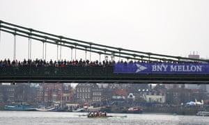 The Cambridge crew pass under Hammersmith Bridge.