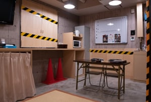 A love hotel in Niigata has a construction site-themed room with traffic cones and a trellis table
