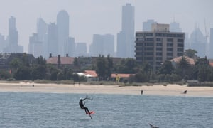 Kite surfers in action at the St Kilda foreshore in Melbourne. The city's temperature was expected to reach 39C on Sunday.