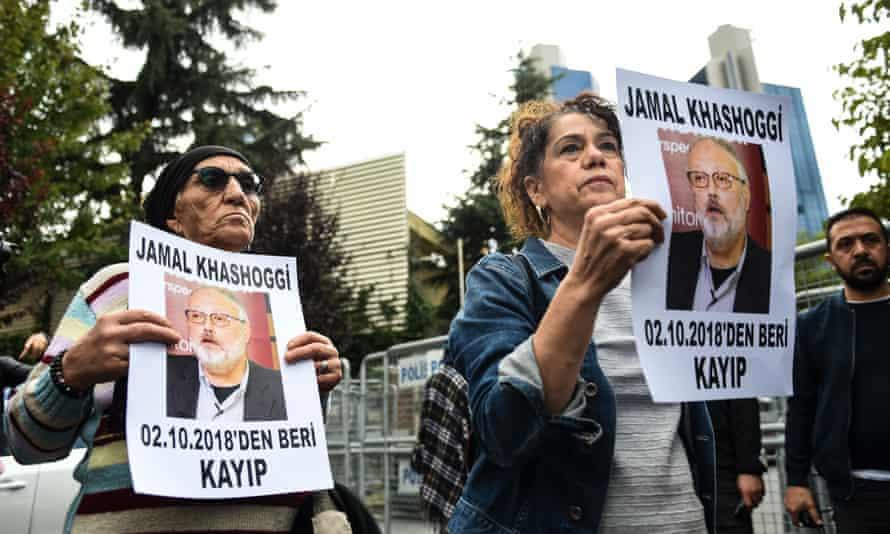 Demonstrators hold portraits of the missing journalist Jamal Khashoggi in Istanbul.