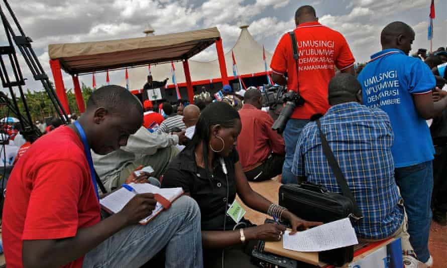 Reporters covering a political rally for the re-election of president Paul Kagame in 2010.