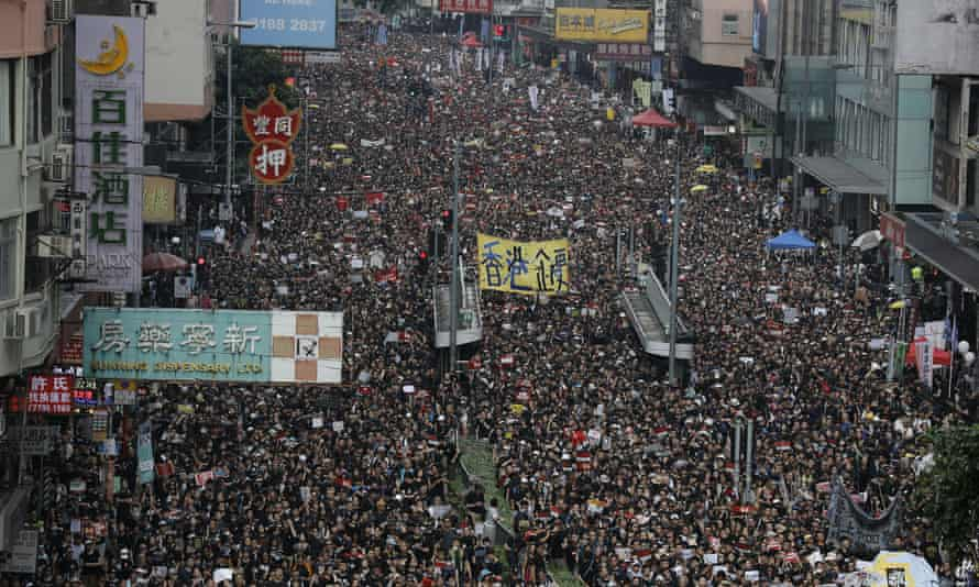 Tens of thousands of protesters march through Hong Kong in June 2019.