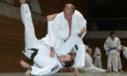 Vladimir Putin throws a judo partner to the floor