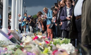 Members of the public look at floral tributes left in memory of Jo Cox.