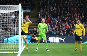 Sokratis clears the ball off the goal line.