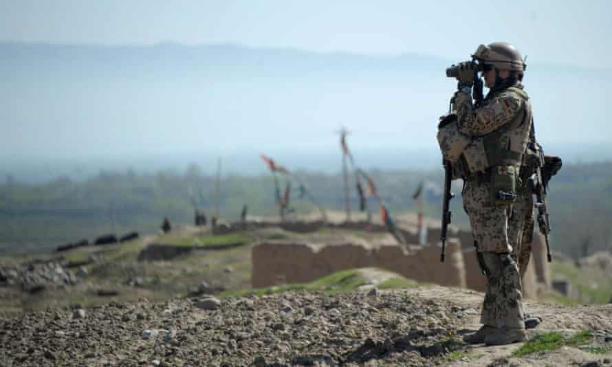 A German soldier keeps watch during a patrol near Taloqan, the capital of Takhar province, Afghanistan, in 2012.