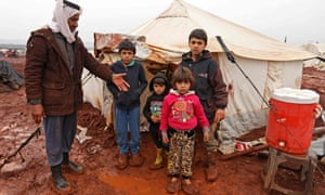 A man and his children at a camp for internally displaced people in Batabu, Syria, January 2018.