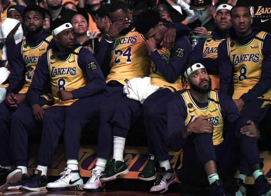 Lebron James and Quinn Cook cry during the Los Angeles Lakers' pre-game ceremony to honour Kobe Bryant at the Staples Center on 31 January in Los Angeles.