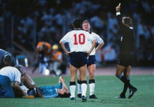 Paul Gascoigne is booked for fouling Thomas Berthold in the Stadio delle Alpi.