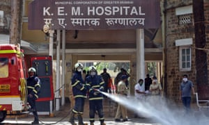 Firefighters disinfect the grounds of a hospital in Mumbai