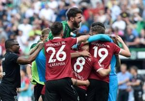 Hannover players celebrate a return to the Bundesliga.