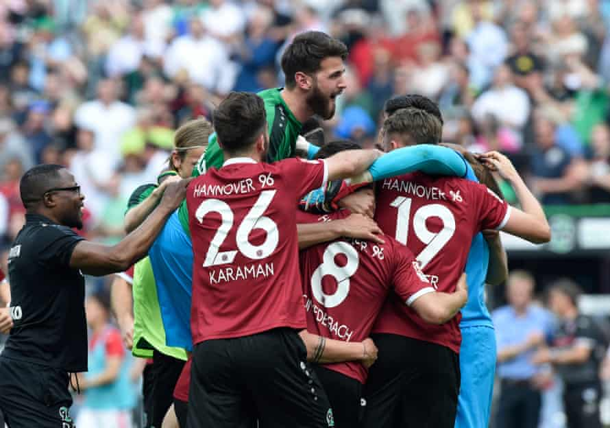 Hannover players celebrate a return to the Bundesliga.