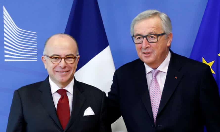 The French prime minister with Jean-Claude Juncker (L) before their meeting in Brussels on Monday.