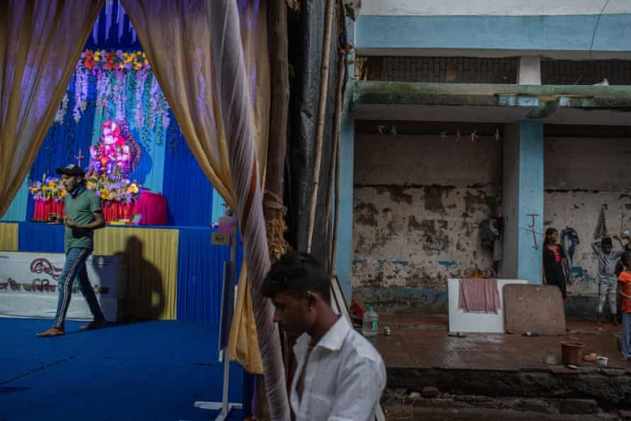 A roadside shrine dedicated to Lord Ganesh outside Grant Road Railway Station, Mumbai.