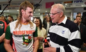 Scott Morrison meets a player, Jarrod Cirkle, at the Bridgenorth Football Club in Launceston during the 2019 Australian federal election campaign.