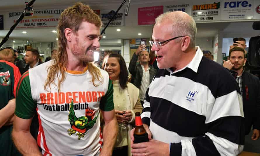 Scott Morrison meets a player, Jarrod Cirkle, at the Bridgenorth Football Club in Launceston during the 2019 Australian federal election campaign.