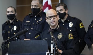 Eddie García, center, a Dallas police chief, during a press conference on the arrest and capital murder charges against fellow officer Bryan Riser.