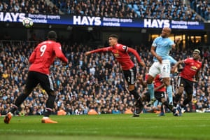 Vincent Kompany beats Smalling to the ball to head in the opener.