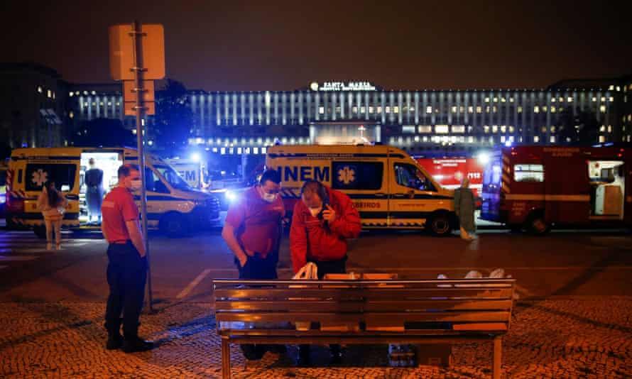 Medical staff choose donated food as ambulances queue at Santa Maria hospital in Lisbon, Portugal, on 27 January.