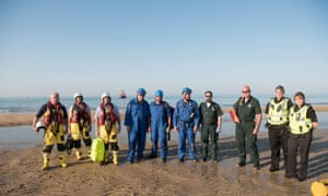 Members of the rescue teams and emergency services who helped rescue a man and child in water off the north east coast of Scotland