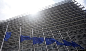 Brussels, Belgium European Union flags fly at half mast outside the European Commission headquarters