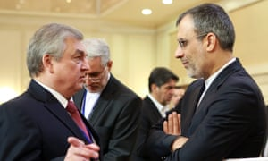 Russia's special presidential envoy on the Syria settlement, Alexander Lavrentiev (left) and the Iranian deputy foreign minister Hossein Jaberi Ansari, in Astana.