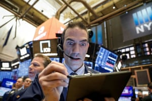 Traders on the floor at the New York Stock Exchange tonight